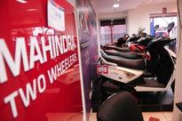 Mahindra to buy out Peugeot's stake in two-wheeler joint venture