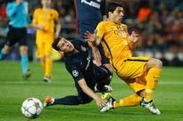 Suarez's double helps Barca beat 10-man Atletico