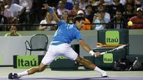 Djokovic withstands back spasm