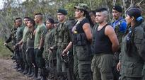 Colombia rebels approve peace accord with Santos government