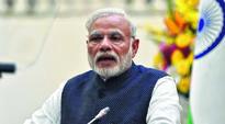 Modi warns of tough action against dishonest, announces sops