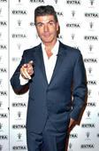 Britain's Got Talent star Susan Boyle praises X Factor's Simon Cowell as a genius