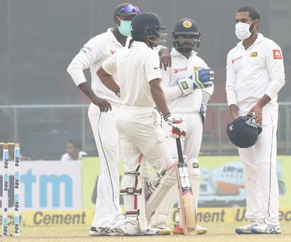PIX: Lankans get 'fussy' over smog-covered Feroz Shah Kotla