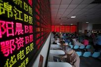 China stocks rise, led by property shares, after Fed leaves rates unchanged