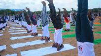 Chennaiites set Guinness record for the most number of headstand at Yoga World Festival