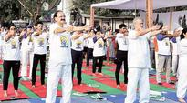 International Yoga Day: In Delhi, mats, bottles and various opinions on yoga