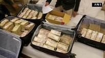 Cops accused of pocketing Rs 25 lakh absconding