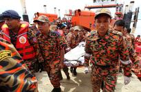 First body found after Malaysia copter crash