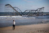 Millions in US at risk from rising seas: study File photo taken on Nov 28, 2012, of a woman looking at a roller coaster was...