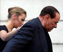 Italys Berlusconi alert and cracking jokes after heart surgery -doctor