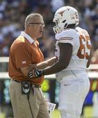 West Virginia hires former Texas line coach Joe Wickline as its offensive coordinator