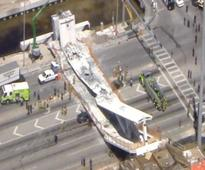 Several killed, cars crushed in footbridge collapse at Florida University