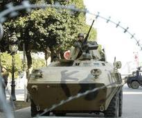Algeria forces hunt militants after policeman assassinated