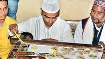 Silk lotuses by Varanasi Muslim weaver shining in Gujarat
