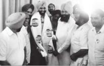 Congress men honour cop with 'proud to be Akali' robe