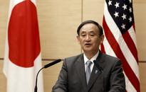 Japan's Suga: Not true PM Abe has decided to delay sales tax hike