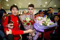 China to curb splashy spending on players
