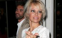 Is Cheryl's ex dating Pamela Anderson?