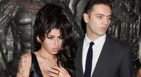 Reg Traviss likes fiancee Amy Winehouse Statue