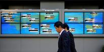 Asia stocks mostly higher, dollar claws back some losses