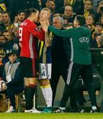 Zlatan Ibrahimovic appears to grab Danish defender Simon Kjaer by the throat
