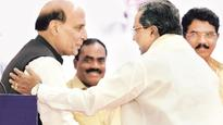 Deshpande crows about state's 'firsts', Rajnath delivers polite snub