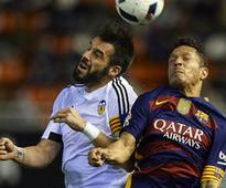 Barca set unbeaten report to see off Neville's Valencia