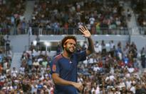 Tsonga brings Evans down to earth in Melbourne
