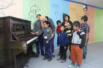 Moved by special kids musical feat, Gulzar presents his piano