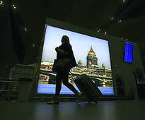 QIA to buy stake in Russian airport A passenger with luggage walks at Pulkovo airport outside St. Petersburg. ...