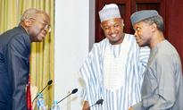 Babatunde Fashola, Minister of Power, Works and Housing (left);  Atiku Bagudu, governor of Kebbi State (middle); and Yemi Osinbajo, vice president, during a courtesy visit by Rice  Farmers Association of Nigeria to the vice president at the Presidential V