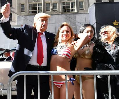 'Trump' takes Times Square with a band of bikini-clad babes