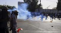 Baghdad Security Forces Fire Tear Gas at Anti-Gov't Protesters
