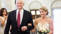 Bride walked down aisle by father's heart reci... Jeni Stepien is walked down the aisle by Tom Thomas. Photo courtesy:  L...