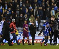 FA Cup: Sergio Aguero's scrap with Wigan fans likely to be investigated by England's Football Association