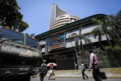 Sensex jumps 216 points after exit polls give BJP an edge