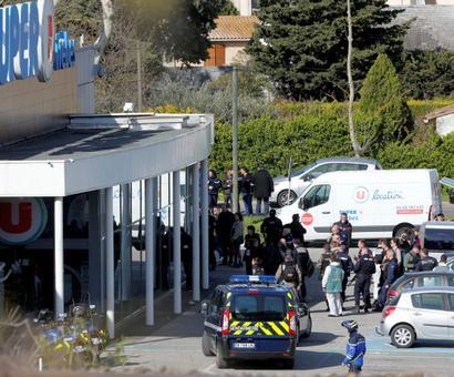 3 dead in France hostage, carjack attacks