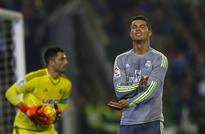 Atletico cede top spot to Barcelona, Real Madrid held