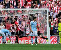 Bilbao fights back to beat 10-man Celta to go ... Athletic Bilbao's defender Mikel San Jose (2ndL) celebrates after scorin...
