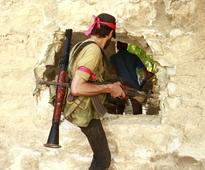 US-backed forces battle Islamic State near Syria ...