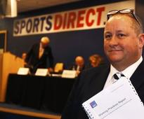 Sports Direct's Ashley defies critics at stormy meeting