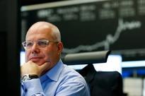 World stocks ride to record high, dollar retreats