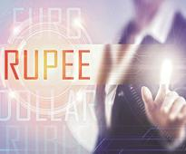 Rupee hits 13-month low of 65.80 against USD amid crude oil concerns