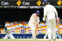 England hold firm after Australia have Cook early