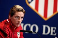 Winning at Atletico all the more special for T... Atletico Madrid's Fernando Torres speaks to the media during a press con...