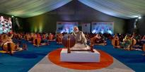 Modi interacting with the women after distributing Charkhas