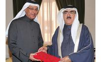 Cabinet Secretary General presented with copy of PhD thesis