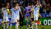Malaga holds on to draw Borussia Dortmund in Champions League