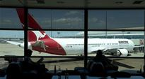 Qantas plane delayed two hours after passenger reported online terror threat