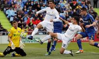 Madrid ease to victory at Getafe to put pressure on Barca